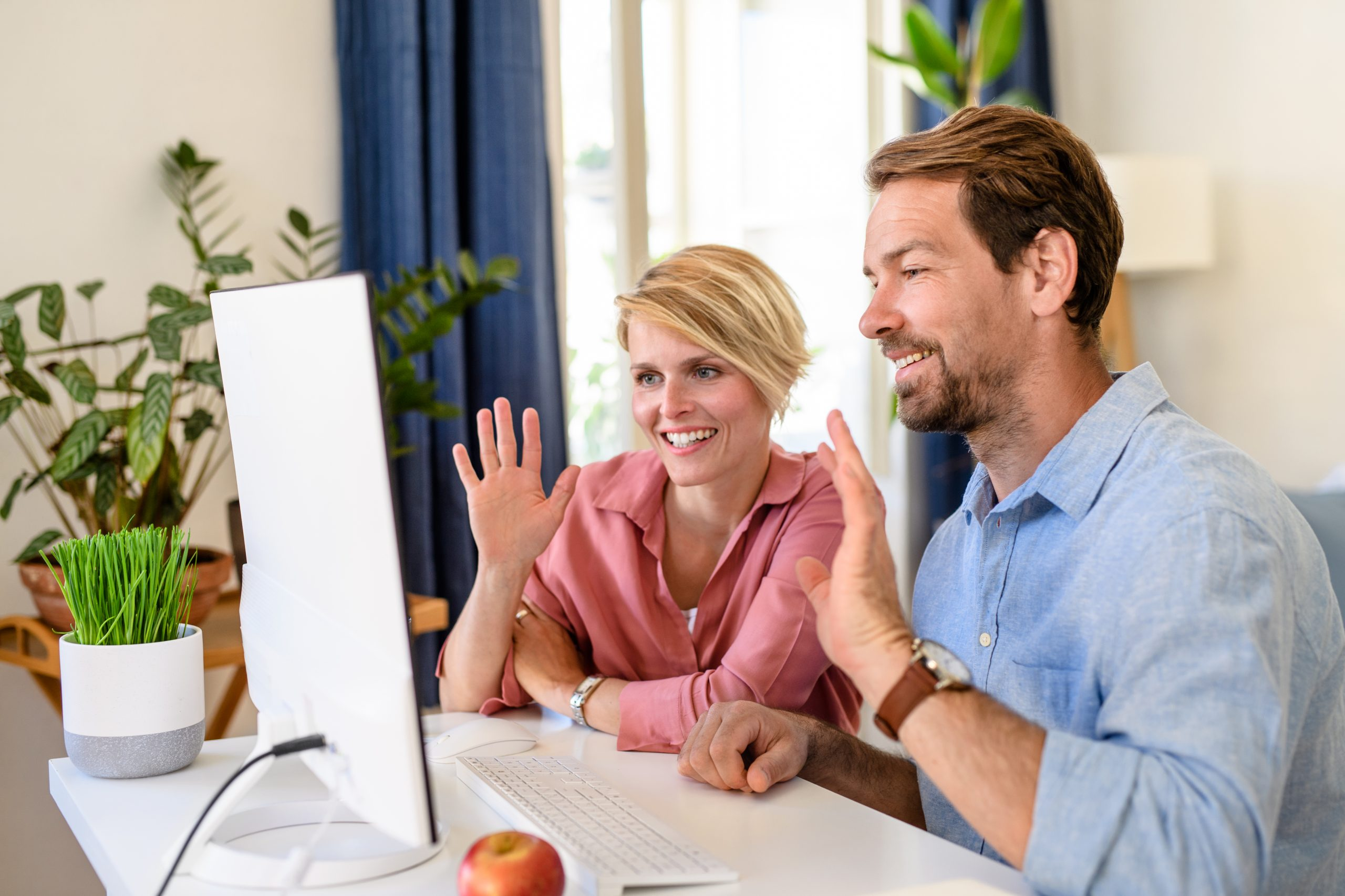 Two people using video conferencing